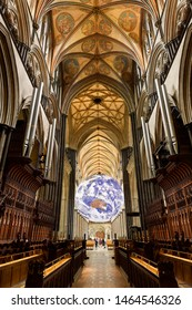 Vaulted ceiling at the front Choir organ pipes with spinning globe inside the medieval Salisbury Cathedral Salisbury, England - June 10, 2019