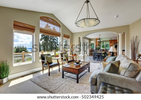 Vaulted Ceiling Living Room With Large Windows Overlooking Beautiful View,  Interior Of Luxury House.