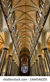 Vaulted ceiling of nave with upper clerestory of medieval Salisbury Cathedral looking to the front with spinning globe Salisbury, England - June 10, 2019