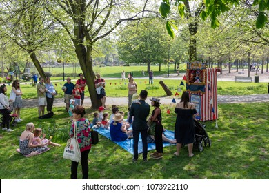 Vauxhall, London, UK; 21st April 2018; Families Watch a Traditional Punch and Judy Show During an Event to Celebrate St Georges Day in Vauxhall Pleasure Gardens