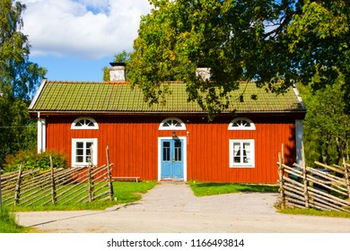 Vaxjo, Smaland / Sweden - September 04 2016: traditional Swedish red and white house or tiny cottage on the countryside