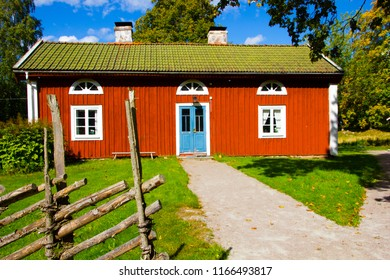 Vaxjo, Smaland / Sweden - September 04 2016: typical and traditional Swedish red and white house or tiny cottage on the countryside