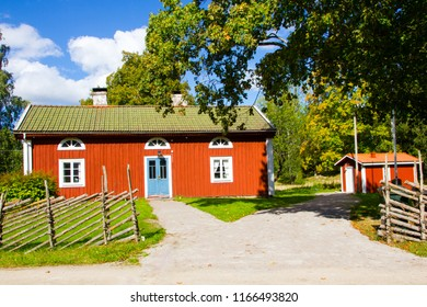 Vaxjo, Smaland / Sweden - September 04 2016:traditional Swedish red and white house or tiny cottage on the countryside