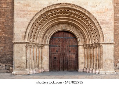 VBig ancient wooden door at the entrance to the Cathedral in Valencia, Spain.