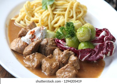 Veal goulash verved with brussel sprouts and spaetzle