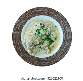 Veal Oscar dish consists of sauteed veal cutlets topped with crab or crayfish meat and bearnaise.