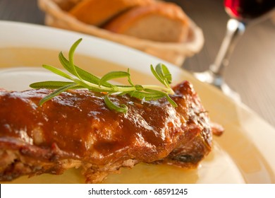 Veal ribs with gravy, rosemary and red winw.