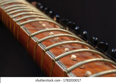 veena Indian musical instrument close up photo. frets in veena