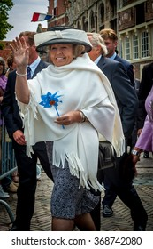 VEERE, NETHERLANDS - JUN 10, 2005: Former Dutch queen Beatrix walking and waving to people in Veere, Zeeland