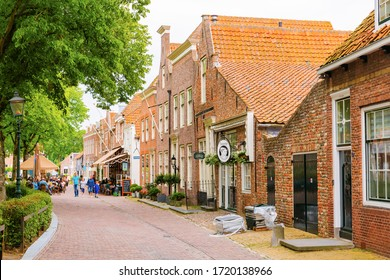 Veere, Netherlands - June 09, 2019: historic buildings in Veere, with unidentified people. Veere is famous for its picturesque old town and a popular destination for day tripper
