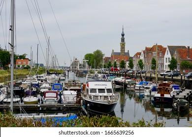 Veere, The Netherlands - june 14 2018; The pleasure boats in the city harbor of historic Veere