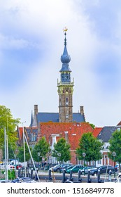 Veere, in the region of Walcheren in the province of Zeeland, Netherlands, view of harbour and tower of gothic town hall building