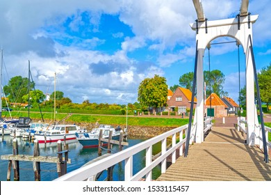 Veere, in the region of Walcheren in the province of Zeeland, Netherlands, view of harbour and Queen Beatrix bridge a typical white Dutch drawbridge as a pedestrian crossing over the canal