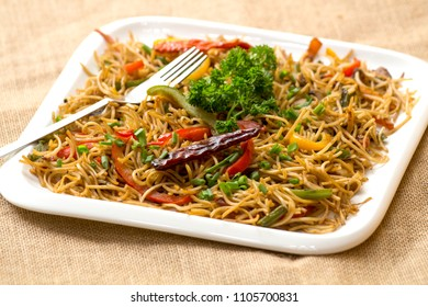 Veg Hakka noodles is an Indo Chinese stir fried noodles with vegetables and Chinese sauce.