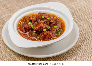 Veg Manchurian with gravy - Popular food of India made of cauliflower florets and other vegetable