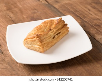 veg puffs served in a white plate on wooden background