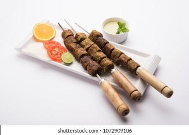 Veg Seekh Kabab served with green salad and chutney
