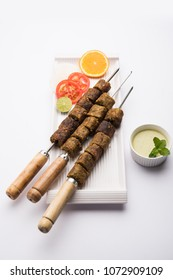 Veg Seekh Kabab served with green salad and chutney