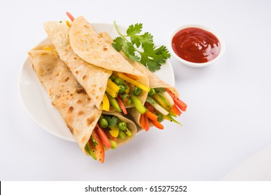 Veg Spring Roll OR Wrap OR Franky, made using Paneer and Vegetables stuffed inside Chapati or Roti. Served with Tomato Ketchup. Selective focus