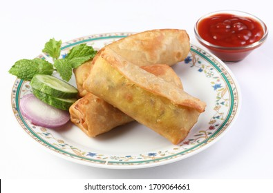 Veg Spring Roll OR Wrap also known as Franky, made using Paneer and Vegetables stuffed inside Chapati or Roti. Served with Tomato Ketchup.