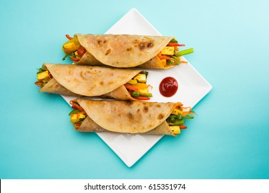 Veg Spring Roll OR Wrap also known as Franky, made using Paneer and Vegetables stuffed inside Chapati or Roti. Served with Tomato Ketchup. Selective focus