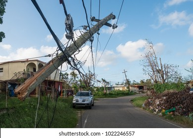 Vega Baja, Puerto Rico / United States -  October 21 2017: Telephone poles were snapped like toothpicks in the winds of Hurricane Maria.