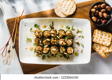 vegan appetizer of grilled zucchini and olive pate on a festive table. healthy food for a family or a party