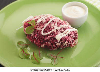 Vegan beet patty with sour cream and red chard
