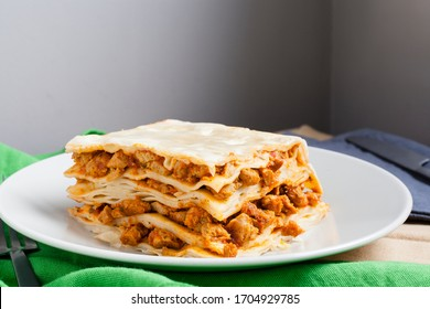 Vegan bolognese sauce lasagna slice made of texturized soy and fresh home made pasta.