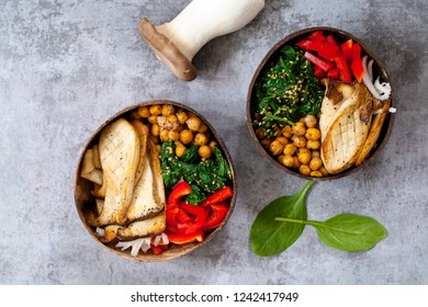 Vegan Buddha bowl with king oyster mushroom, chickpeas, spinach and red pepper