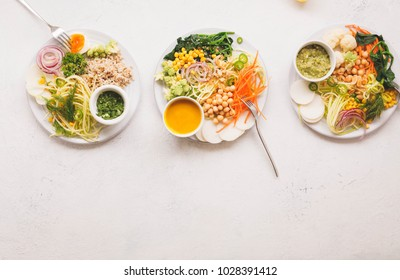 Vegan buddha bowls variety vegetable food meals plate plant based meals white table copy space