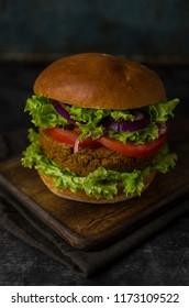 Vegan burger on cutting board