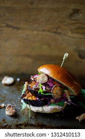Vegan burger with white bean puree and spicy aubergine slices