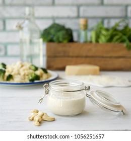 Vegan cashew cream sauce for pasta. Light wooden background