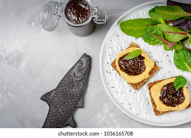 Vegan caviar made with chia seeds and nori. Appetizers on whole grain crispbreads  with hummus