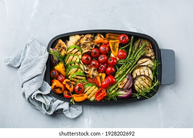 Vegan charcuterie, vegetarian, seasonal, summer eating concept. Grilled vegetables in a pan on a table. Top view flat lay background