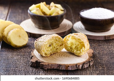 Vegan cheese bread, made in Brazil without animal products, using tapioca (manioc flour) and potatoes. Organic products on rustic wooden background.