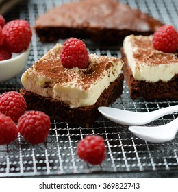 Vegan Chocolate cake with frosting and raspberries