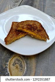 Vegan comfort food with a vegan grilled cheese sandwich on a wooden background