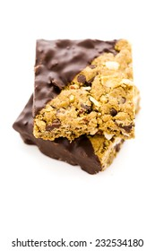 Vegan Cowgirl Squares dippen in chocolate on a white background.