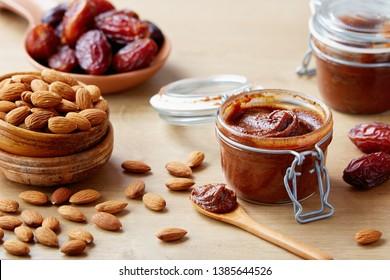 Vegan date spread with almonds (sugar-free). Jar of homemade vegan date spread.