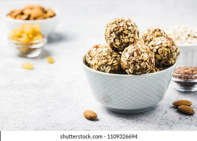 Vegan dessert, raw oatmeal nuts fruit bites. Selective focus, space for text.