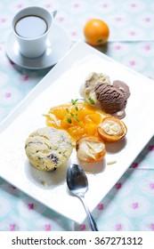 vegan dessert: soy ice cream, muffin, medlars and fruit sauce