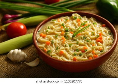 Vegan diet food concept- Homemade spicy noodle soup with fresh vegetables.