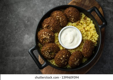 Vegan falafel with rice and sauce