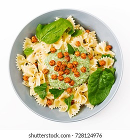 Vegan Farfalle pasta with spinach  sauce with fried chickpeas. Proper nutrition. Sports nutrition. Dietary menu. Flat lay. Top view