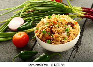 Vegan food background with wheat noodles and vegetables.