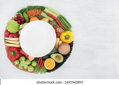 Vegan food for clean eating concept with foods high in protein, vitamins, minerals, anthocyanins, antioxidants, omega 3, smart carbs and dietary fibre. Flat lay on rustic wood background. Copy space.
