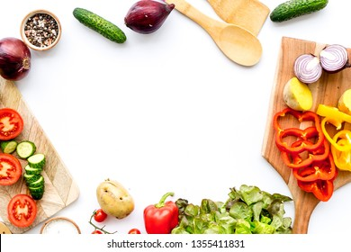 Vegan food cooking with raw vegetables on white background top view mock up