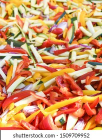 Vegan food, diet. Vegetable sticks, pasta from carrot, zucchini, bell pepper. Mexican food festival. Top view  and closeup. Ingredients for fajitas, tacos and quesadilla traditional food. National Day